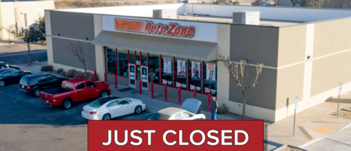"""The words """"just closed"""" over an AutoZone buliding"""
